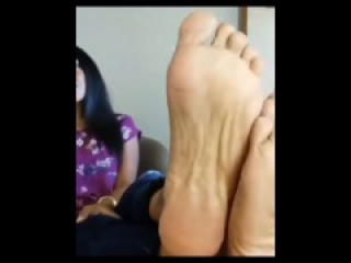 Gorgeous ebony woman showing off her sexy soles